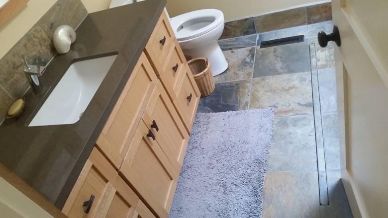 "Herbert custom bathroom with hand built oak vanity, Caesar Stone counter, slate backsplash, floor & base""boards"" & stainless steel trench floor drain"