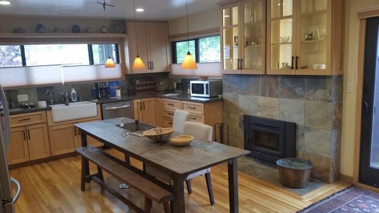 Betsy Herbert custom kitchen with fireplace insert, hand built oak cabinets, farm sink, Caesar Stone counters, slate backsplash & fireplace surround. Upper Westside, Santa Cruz.
