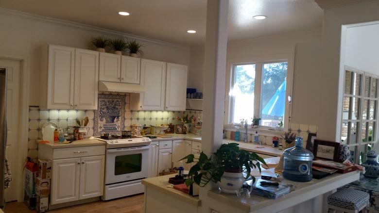 Zuchert custom kitchen, modular cabinets, complete floor framing rebuild, wood grain floor tile, handmade Portuguese tile backsplash, window upgrade & more. Bonny Doon